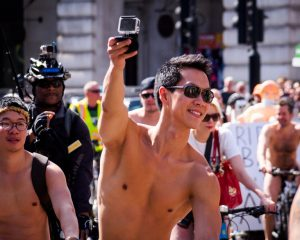 A naked rider takes a selfie