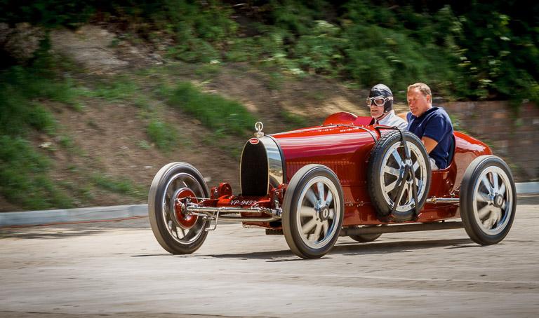 An accelerating Bugatti